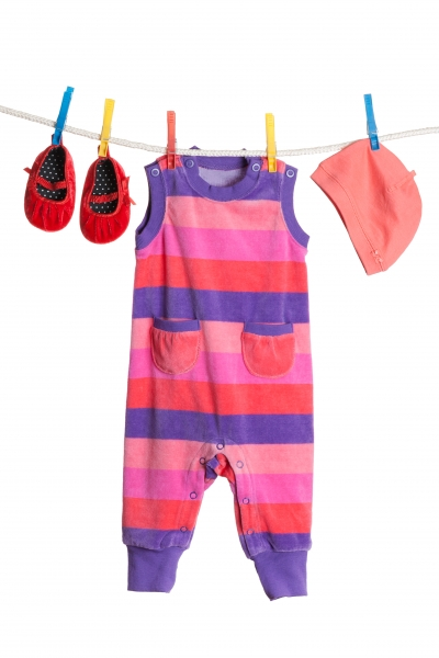 a-set-of-children-s-clothes-hanging-on-a-clothesline